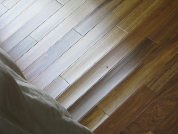 Hardwood floor water damage certified restoration for How to fix buckling hardwood floors