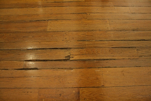 Hardwood floor water damage certified restoration for Hardwood floors warping