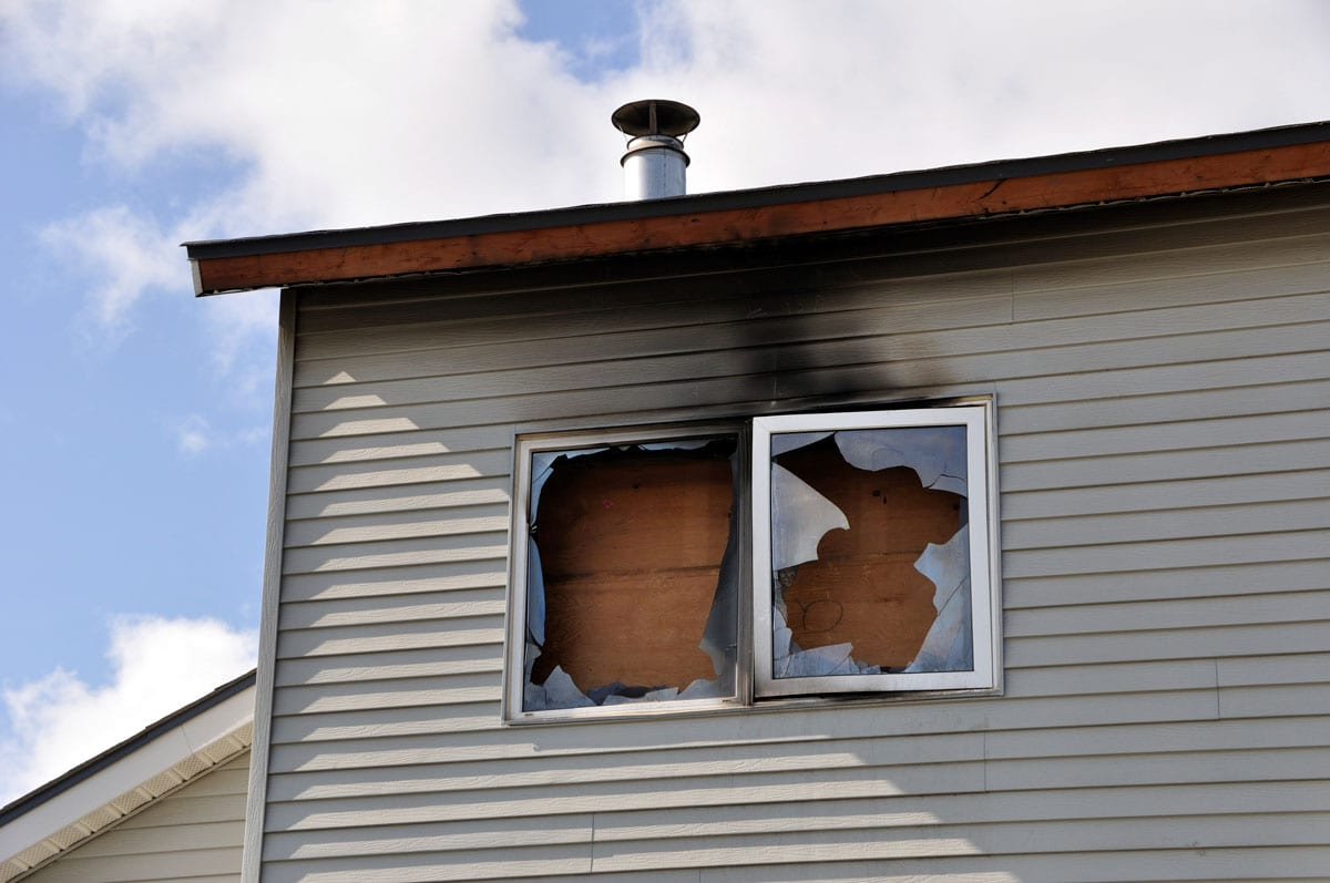 exterior image of home in need of fire and smoke damage restoration